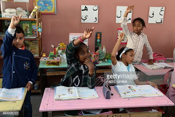 A young subSaharan migrant attends an Arabic class on May 12 2014 at a school in the Moroccan capital Rabat The Moroccan government has put into...