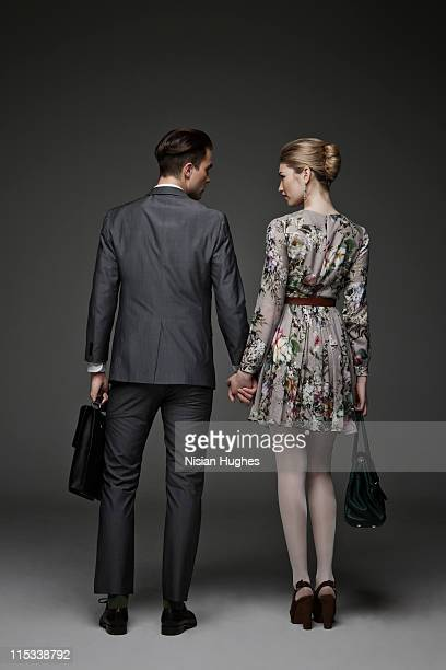 young successful couple holding hands