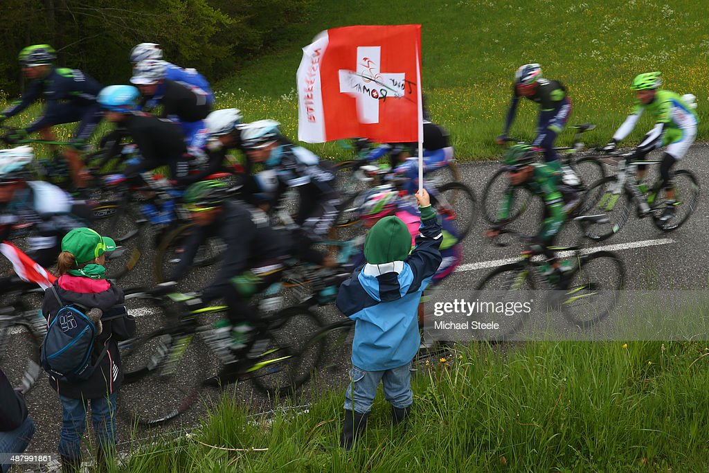A young supporter flies the Swiss flag as the peloton passes by during stage four of the Tour de Romandie from Fribourg to Fribourg on May 3, 2014 in Fribourg, Switzerland.