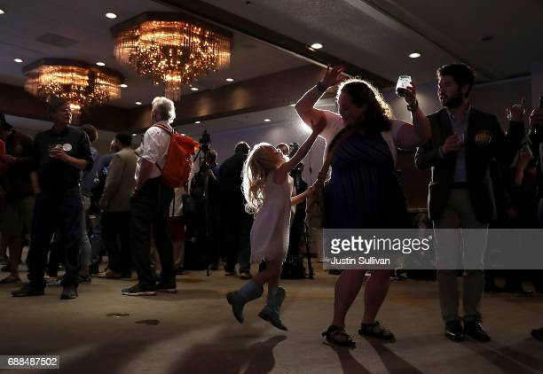 A young supporter of Democratic US Congresstional candidate Rob Quist dances during an election night gathering the DoubleTree by Hilton Hotel...