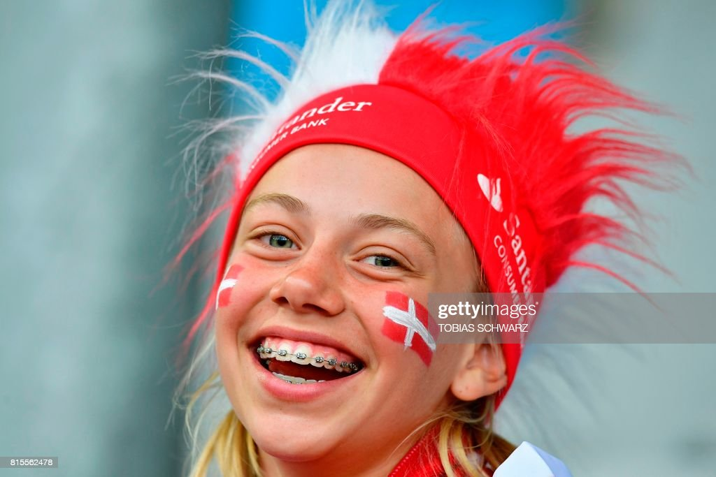 A young supporter of Denmark's national soccer team looks on before the UEFA Women's Euro 2017 football tournament between Denmark and Belgium at Stadium De Vijverberg in Doetinchem on July 16, 2017. /