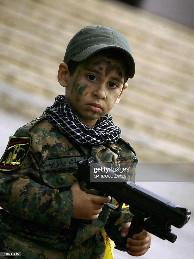 A young supporter of Lebanon's militant Shiite Muslim movement Hezbollah takes part in a a parade on the eve of the peak for the mourning period of...