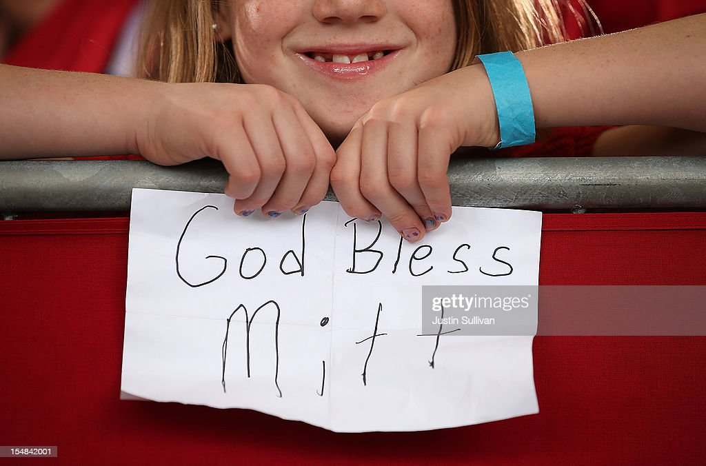 A young supporter of Republican presidential candidate, former Massachusetts Gov. Mitt Romney holds a homemade sign during a campaign rally at Ranger Jet Center on October 27, 2012 in Kissimmee, Florida. With less than two weeks before election day, Mitt Romney is campaigning in Florida.