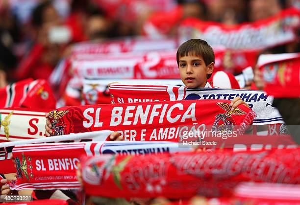 A young supporter of SL Benfica looks on amongst a forest of scarves during the UEFA Europa League Round of 16 2nd leg match between SL Benfica and...