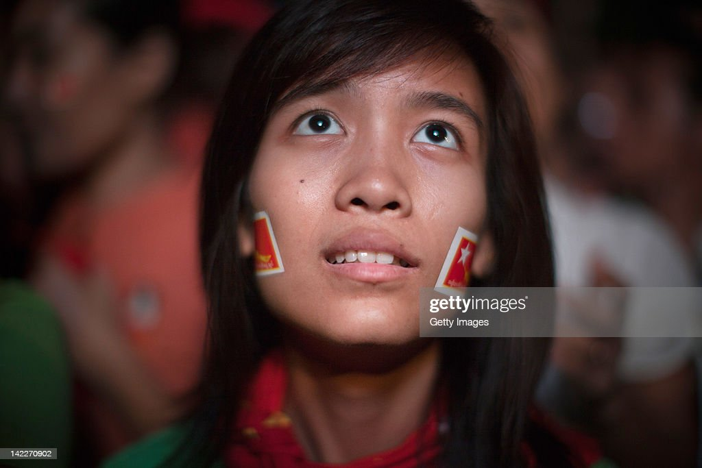 A young supporter of the National League for Democracy waits for preliminary election results outside of the part office April 1 2012 in Yangon...