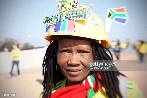 A young supporter of the South African national football team wearing a makarapa heads to Soccer City stadium in Soweto suburban Johannesburg for the...