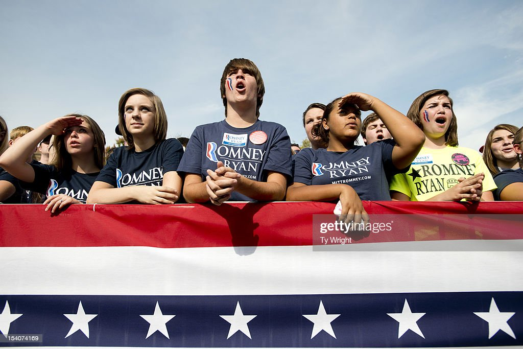 Young supporters listen as Governor Mitt Romney speaks to a crowd at Shawnee State University on October 13, 2012 in Portsmouth, Ohio. The Romney and Obama campaigns have been concentrating their efforts on Ohio to gain more supporters as Election Day approaches.