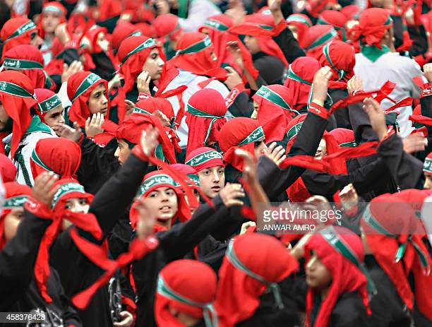 Young supporters of Lebanon's militant Shiite Muslim movement Hezbollah take part in a parade during the Ashura commemorations that mark the killing...