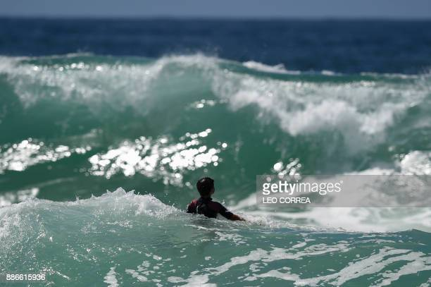 Young surfer Rickson Falcao waits for a wave at Saquarema's beach in Rio de Janeiro state Brazil on November 29 2017 Despite its vast Atlantic...