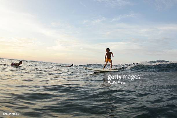 A young surfer rides a wave in Cloud 9 Siargao a day before the Siargao Cloud 9 Surfing Cup on September 24 2014 This year's Siargao Cloud 9 Surfing...