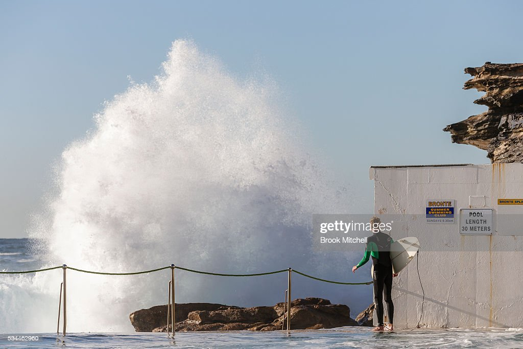 A young surfer waits to paddle out at Bronte Beach on May 25, 2016 in Sydney, Australia. All Sydney beaches were closed to swimmers today as large waves pounded the coast.