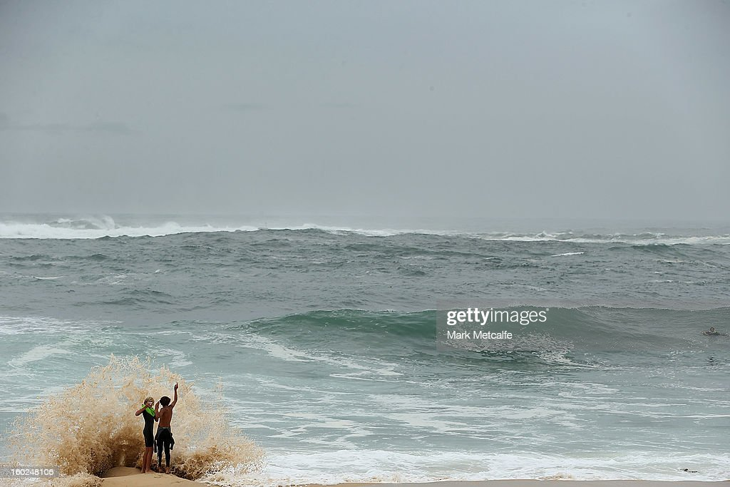 Young surfers watch the conditions at Coogee Beach after winds and rain battered Sydney last night on January 29, 2013 in Sydney, Australia. Parts of Sydney are experienced record rainfall after ex-cyclone Oswald swept through the city last night.