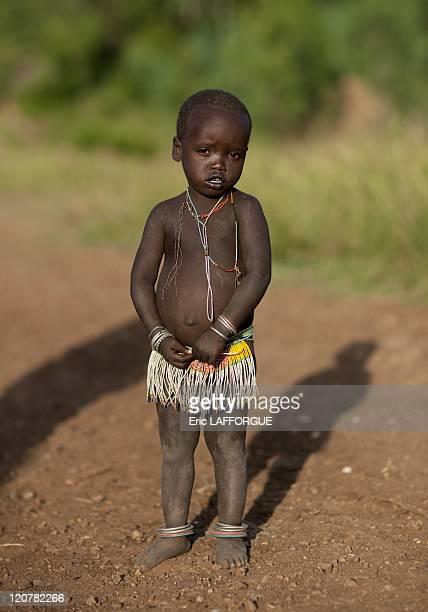 Young Surma girl in Turgit village Omo valley Ethiopia on July 03 2010 Surma or Suri are sedentary pastoral people living in south west of Ethiopia...