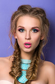 Young surprised woman with bright candy colors make-up. Colourful smokey eyes. Summer fashion makeup.