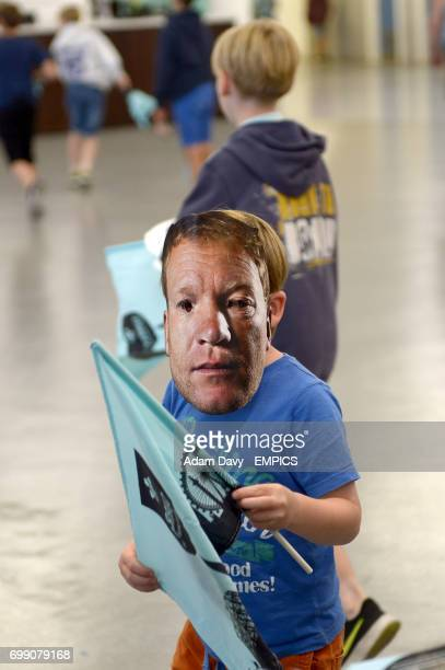 A young Surrey fan with a Gareth Batty mask on