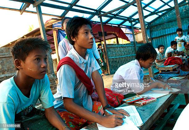Young survivors of cyclone Nargis attend a temporary school in a devastated village According to official figures the cyclone killed about 140000...