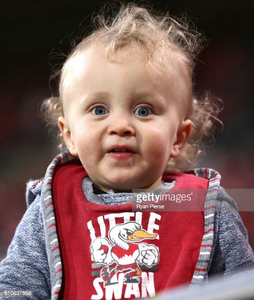 A young Swans fan looks on during the round 16 AFL match between the Sydney Swans and the Gold Coast Suns at Sydney Cricket Ground on July 8 2017 in...