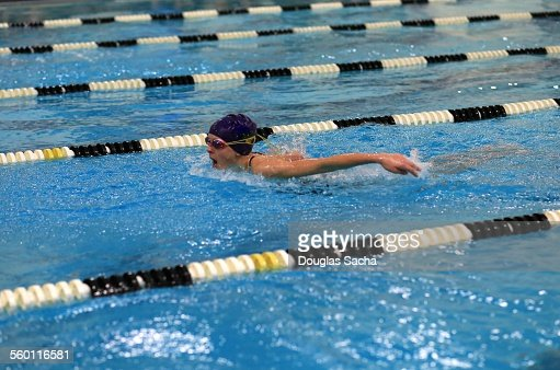 Young swimmer performs the butterfly stroke