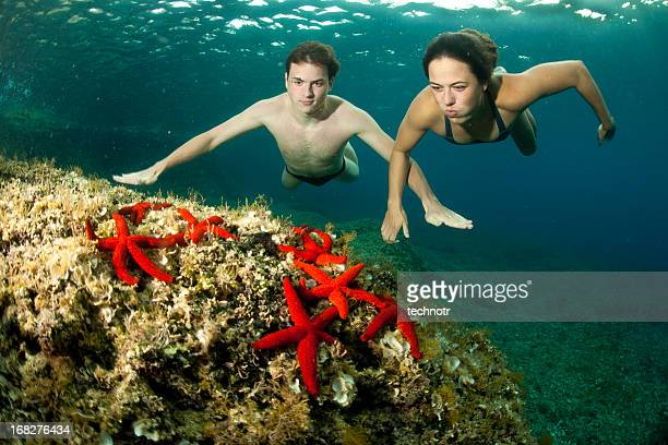 Young swimmers enjoying underwater