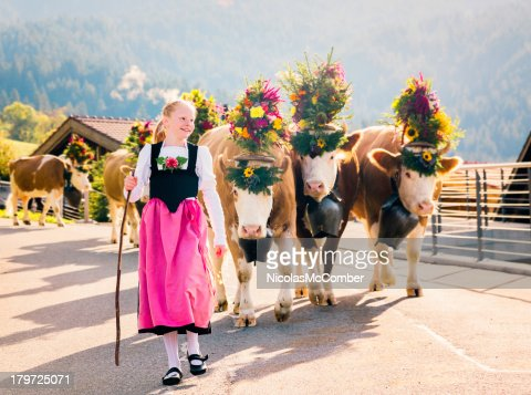 Young Swiss Farmer Girl Leading Cows to Fair