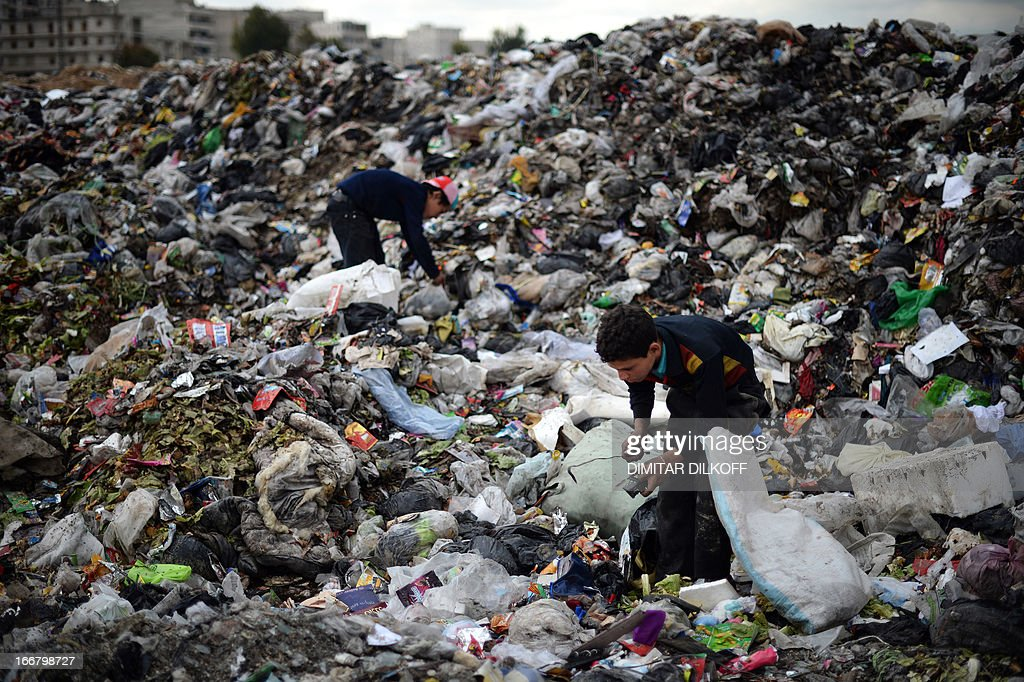 Young Syrian boys collect plastic and metal items in a garbage dump in the northern Syrian city of Aleppo on April 17, 2013. Russian Foreign Minister Sergei Lavrov criticised the Friends of Syria grouping of Western and Arab countries opposed to the rule of President Bashar al-Assad as negative for dialogue.