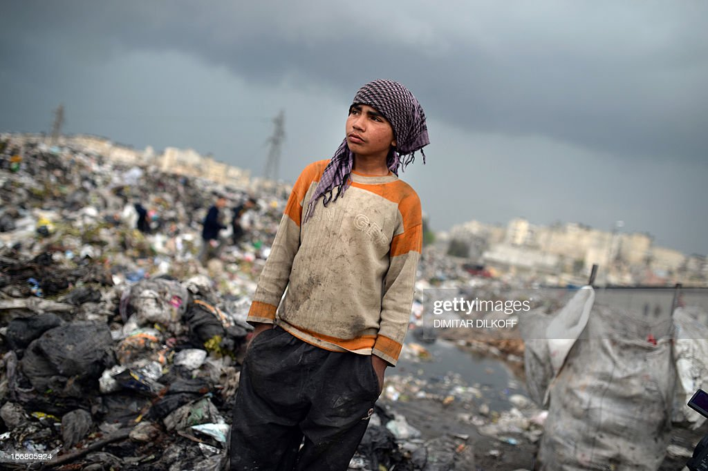 A young Syrian boys takes a rest after collecting plastic and metal items in a garbage dump in the northern Syrian city of Aleppo on April 17, 2013. Russian Foreign Minister Sergei Lavrov criticised the Friends of Syria grouping of Western and Arab countries opposed to the rule of President Bashar al-Assad as negative for dialogue.