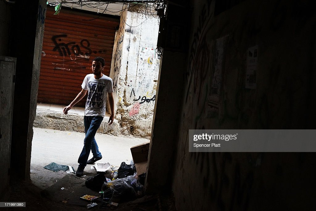 A young Syrian man walks in a poor neighborhood with a high concentration of Syrian refugees on June 30, 2013 in Beirut, Lebanon. Currently the Lebanese government officially hosts 546,000 Syrians with an estimated additional 500,000 who have not registered with the United Nations. Lebanon, a country of only 4 million people, is now home to the largest number of Syrian refugees who have fled the conflict. The situation is beginning to put a huge social and political strains on Lebanon as there is currently no end in sight to the war in Syria.