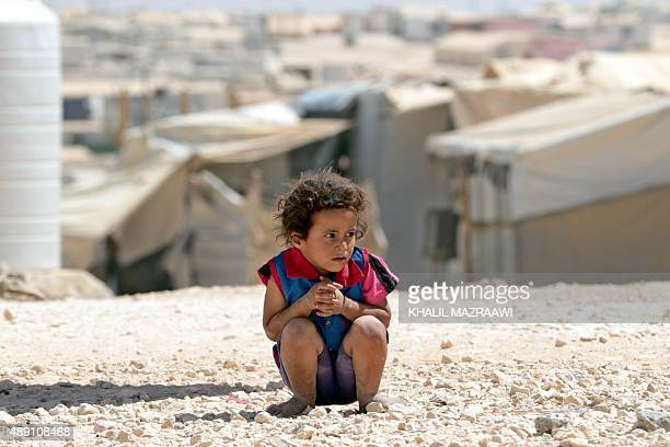A young Syrian refugee looks on at the UNrun Zaatari camp north east of the Jordanian capital Amman on September 19 2015 UN Humanitarian Chief...