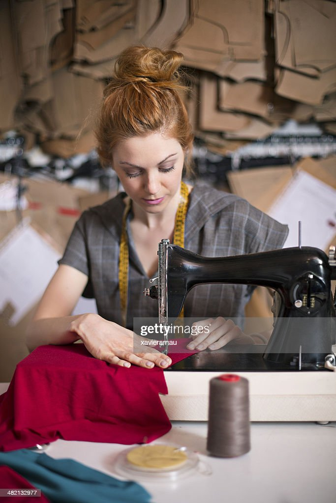 Young tailor sewing : Stock Photo