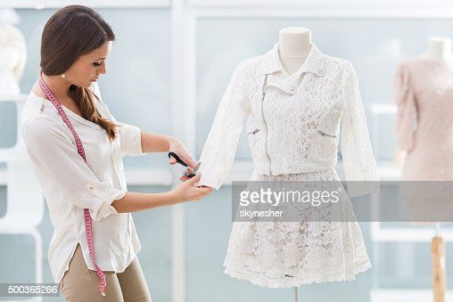 Young tailor working in clothing design studio.