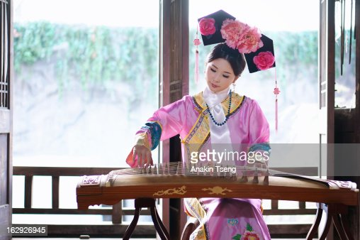 young Taiwanese woman playing instrument