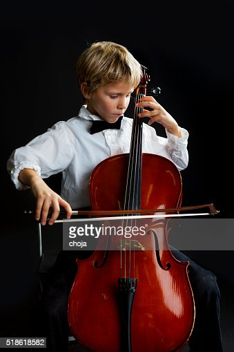 Young talented boy playing cello