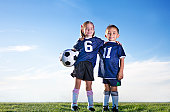 Two Young ethnically diverse soccer players on a youth soccer team
