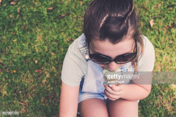 Young Teen eating an ice cream cone