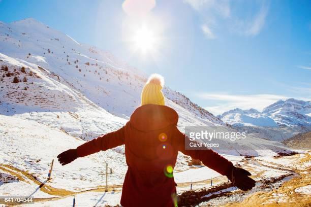 young teen enjoying snow.ReR  VIEW