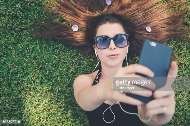 Young Teen taking selfie on phone