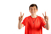 Young teenage boy isolated on white giving double peace sign