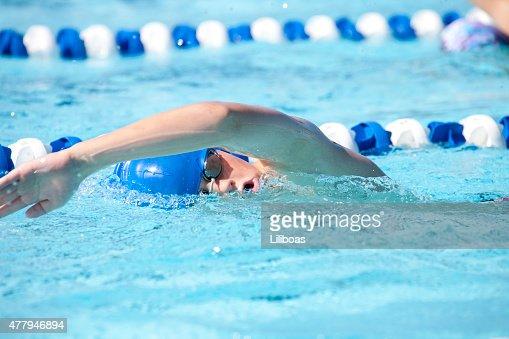 Young Teenage Boy Swimming Freestyle Swim Stroke