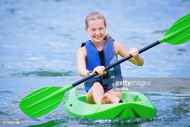 Young Teenage Girl Having Fun Kayaking in Lake