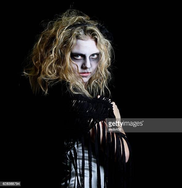 Young teenage girl in Halloween costume