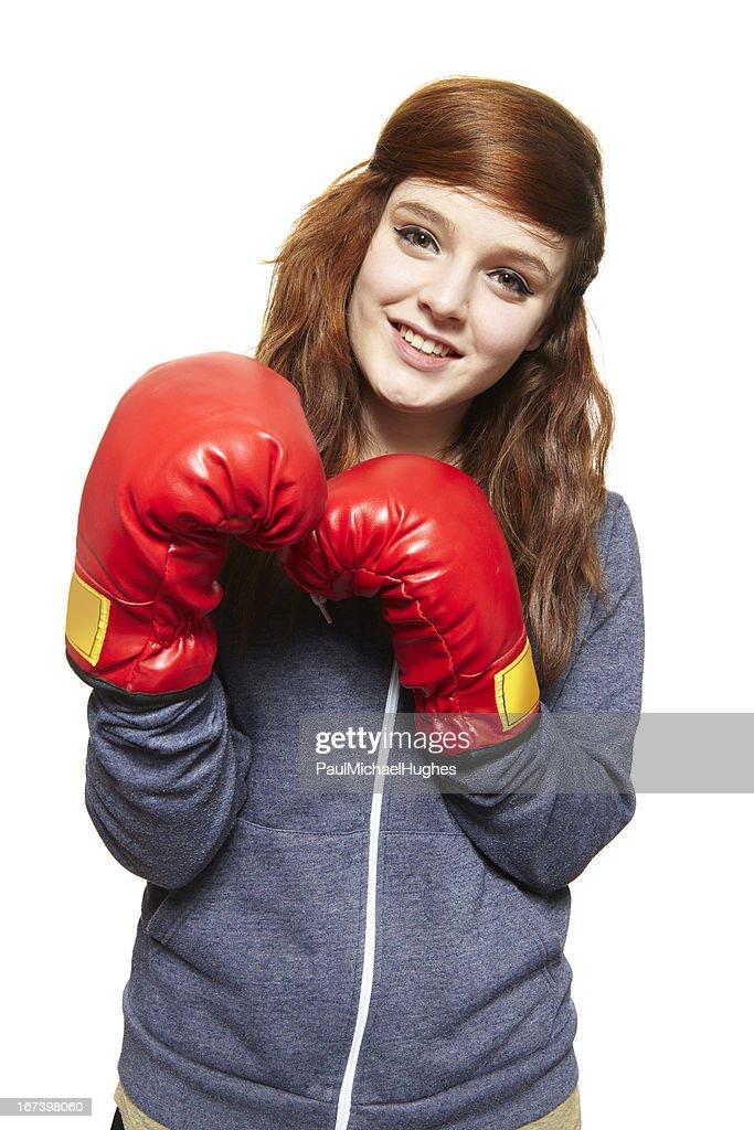 Young teenage girl wearing boxing gloves smiling : Stockfoto