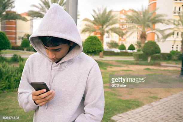 Young Teenager using his smartphone