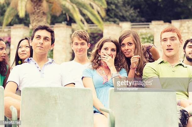 young teenagers watching a film at cinema