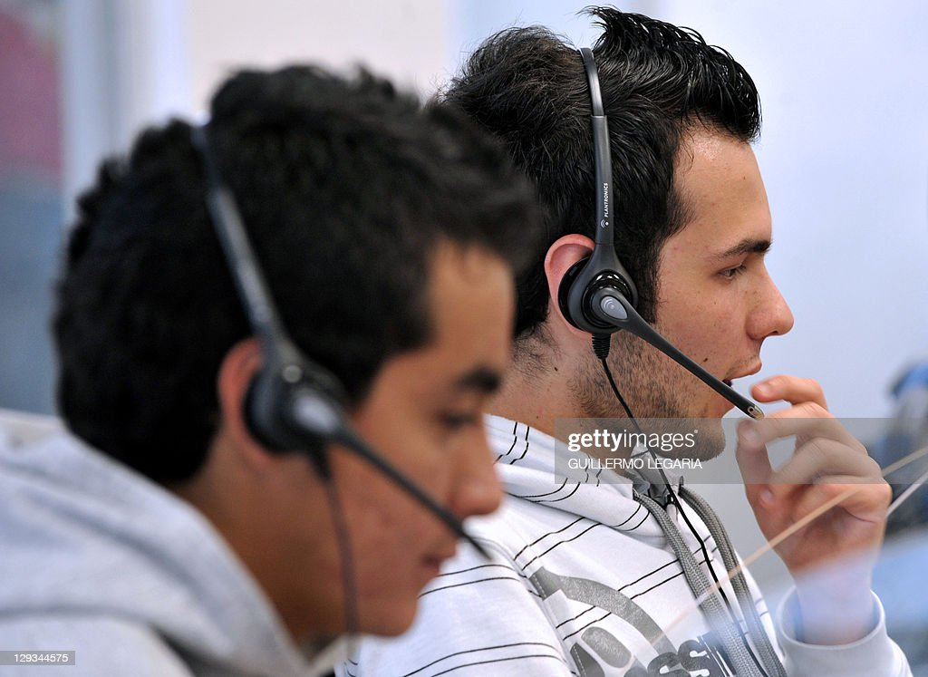 BAUTISTA - Young telemarketers work in a call center in Manizales, Caldas Department, Colombia, on September 20, 2011. Thousands of inhabitants of Manizales highlight in the Latin American market of Call Centers due to their impecable Spanish and kindness, which make them able to overcome unemployment and keep them separate from coffee production, from which they have depended for years. AFP PHOTO/Guillermo LEGARIA