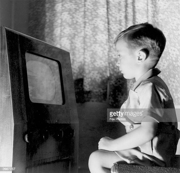 Young television viewer Malcolm Graves watching his favourite programme 'Muffin The Mule' at home in Harrow