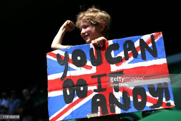 A young tennis fan holds a Union Jack banner with a message of support for Andy Murray of Great Britain ahead of his Gentlemen's Singles final match...