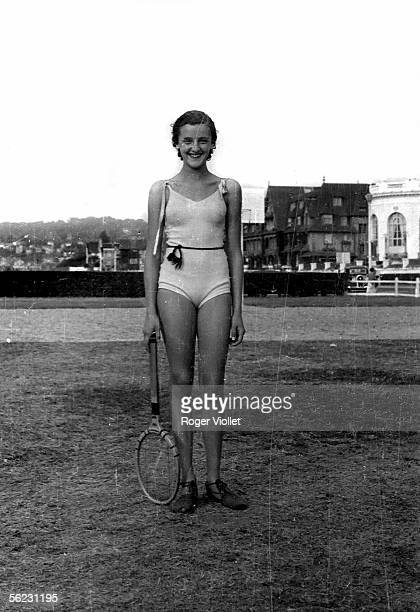 Young tennis player on the beach of Deauville About 1930 LEI18623