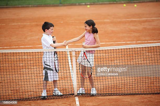 Young Tennis Players Shaking Hands