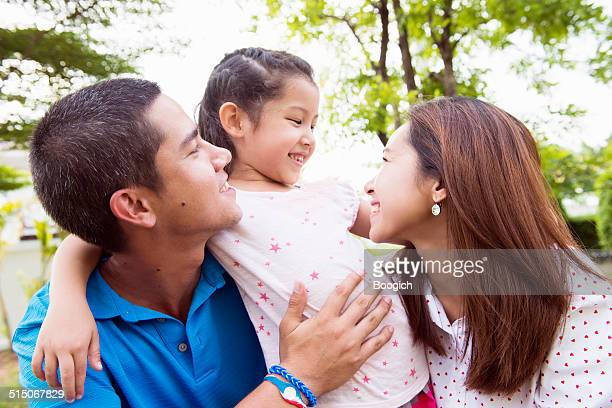 Young Thai Family Spending Time Outdoors