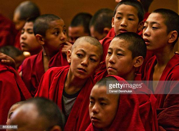 Young Tibetan Buddhist monks inexile pray during a Long Life prayer offerings ceremony to his Holiness the Dalai Lama at the main temple Tsuglag...